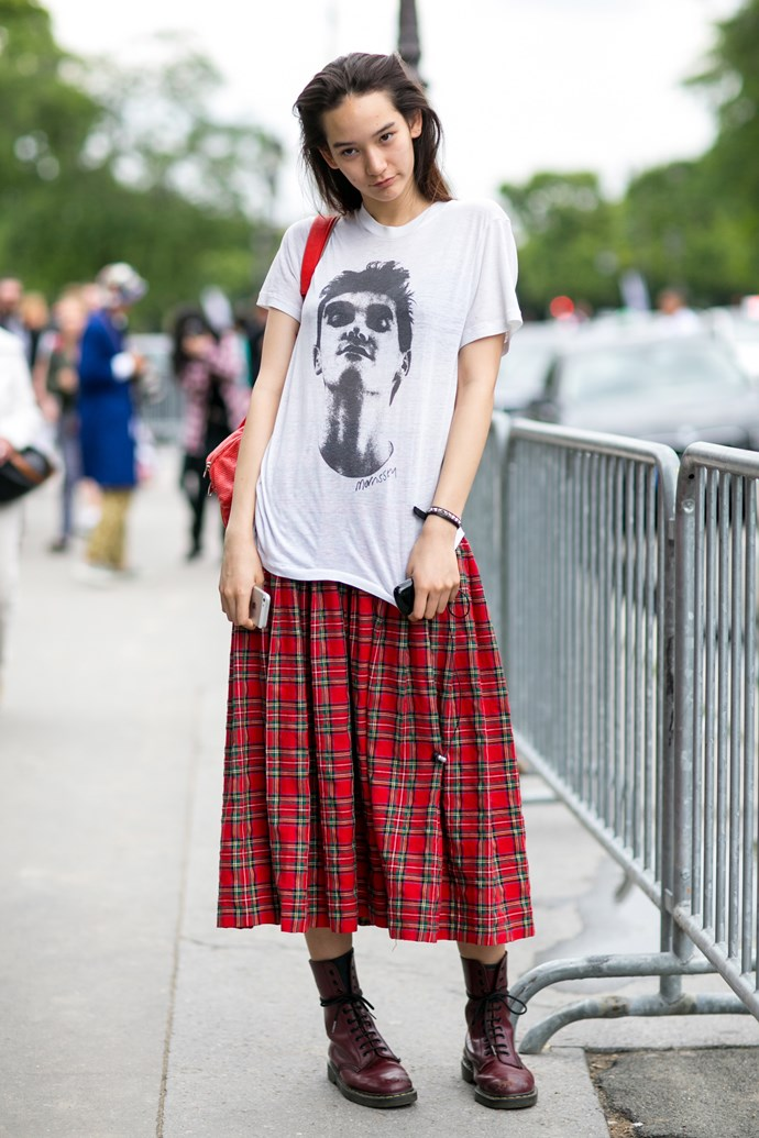 Another punk-inspired look at the shows. This model rocks a kilt, oversized band tee and docs.