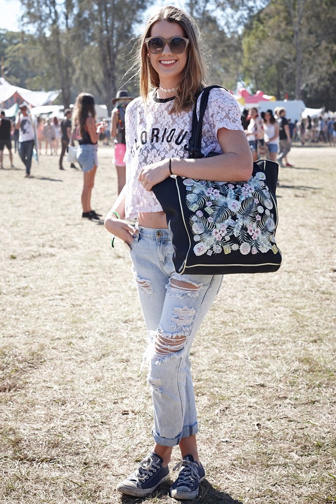 Jess nails casual-cool in ripped One Teaspoon denim, Converse sneakers and a floral carry-all. Bonus points for bringing the daisy chain choker back. <br><br> Image: Julie Adams