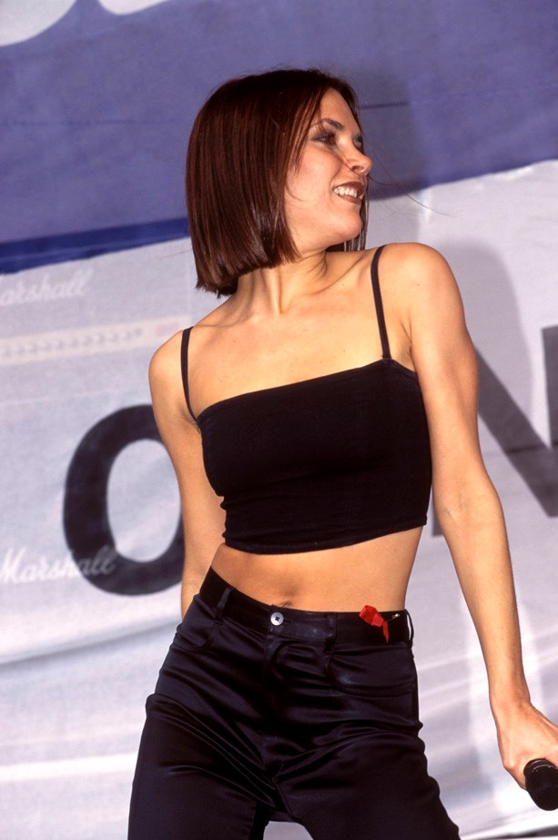 Classic Posh Spice: Black crop and high-waisted pants. Simple, but very 90s chic.