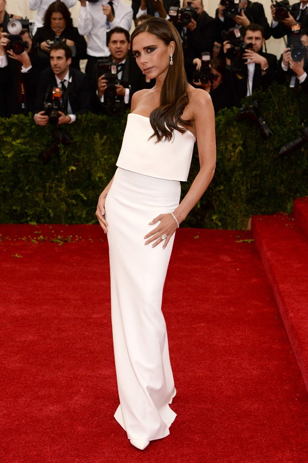 """Victoria looked so chic and elegant in her own white column design at the """"Charles James: Beyond Fashion"""" Costume Institute Gala in 2014."""