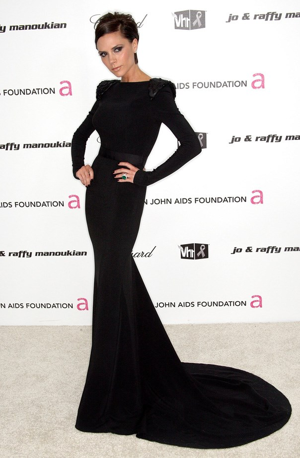 Victoria Beckham at the 7th Annual Elton John AIDS Foundation's Academy Award ceremony wearing a black jersey dress, with sequined shoulders from her own AW09 collection.