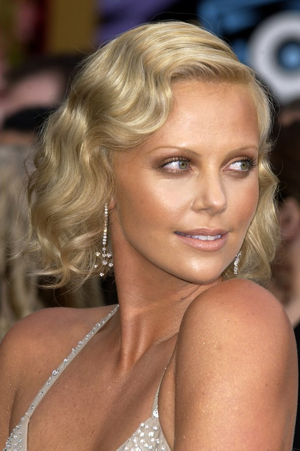 Arriving at the 76th Annual Academy Awards the actress paired finger waves with a golden tan.