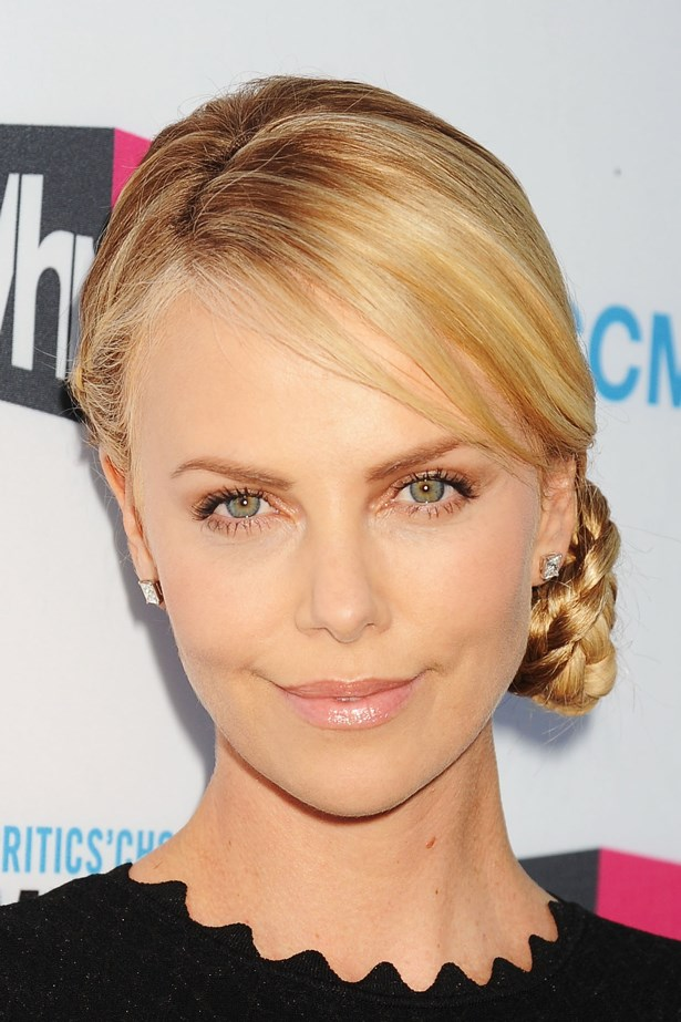 Charlize wore a side braid and low bun to an event in 2012.