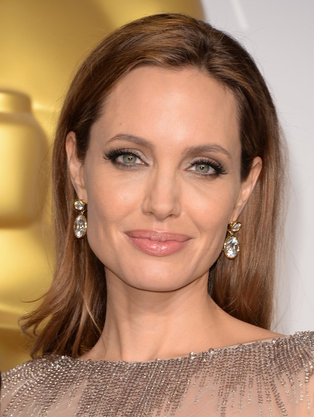 <strong>Angelina Jolie's lips and jawbone</strong><br> We couldn't decide what we would want more, Angelina's lips or her chiseled faceshape. The actress is a pro at enhancing both, in the most beautiful and feminine way, usually in the form of strong or glossy lipstick or opting for a hairstyle (like this one) that will sweep back and reveal her swan-like long neck and jawline.