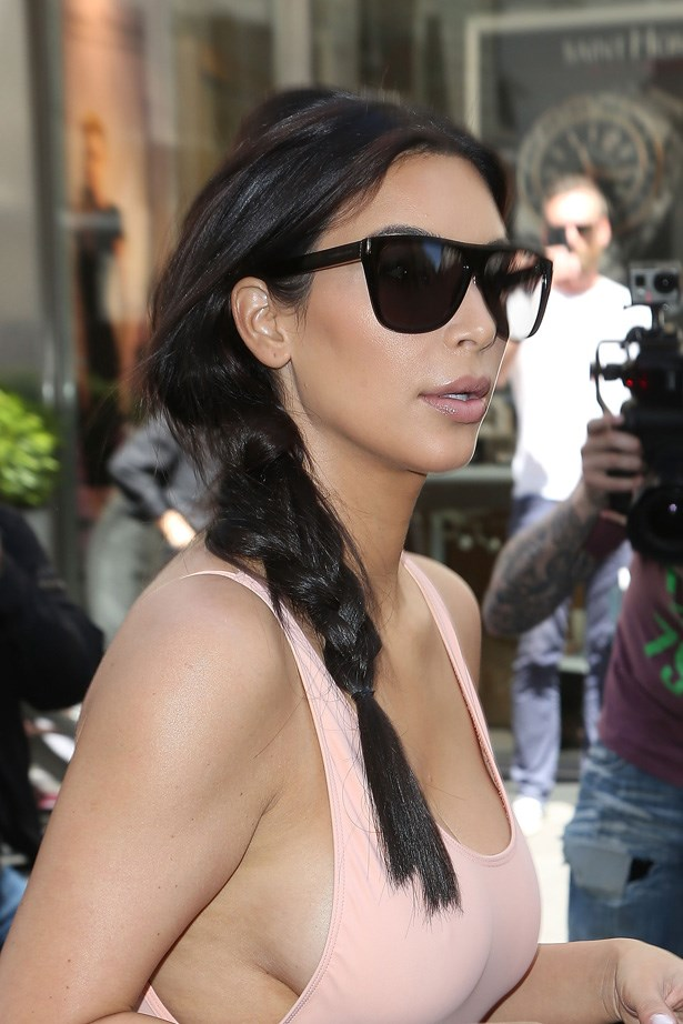 Kim Kardashian's loose, swept-back braid is on point for a saturday morning yoga class. Laid-back and chic.