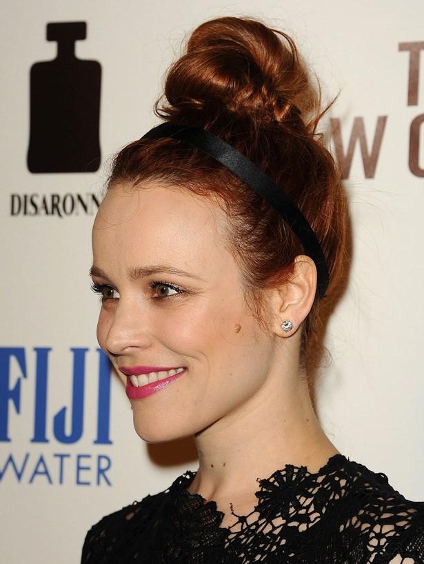 Dress up a top knot with a simple headband, like Rachel McAdams. Cute.