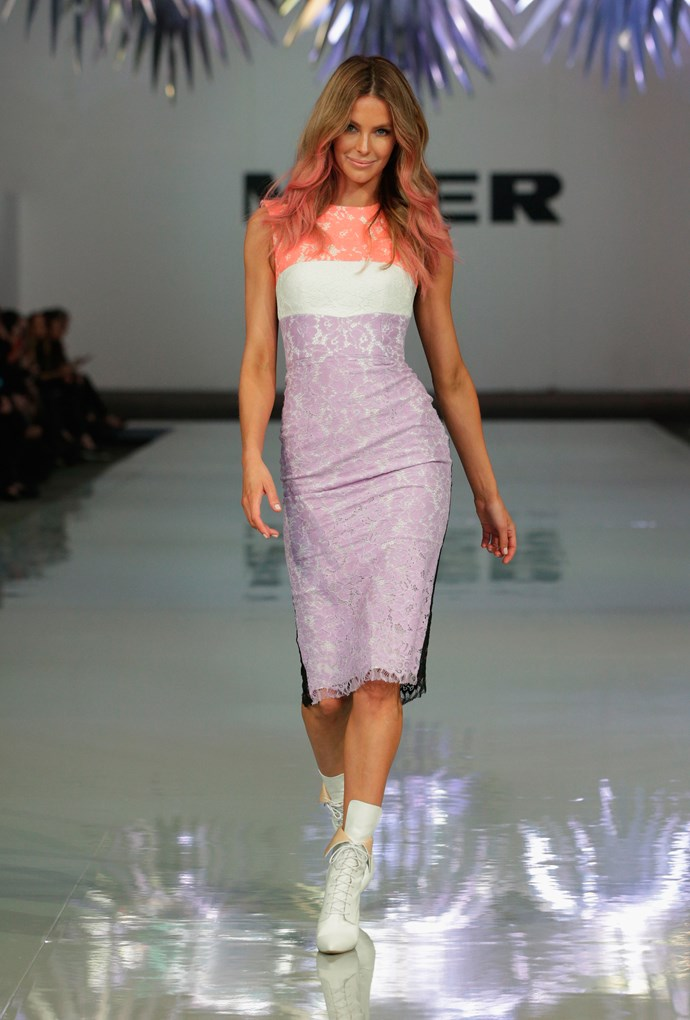 "Jennifer Hawkin's opened Myer's SS15 show in a stunnign Alex Perry lace dress. Before the show we spoke to Perry about the opening look and he describes it as a soft-serve of Neapolitan.  <br><br>""Think of Neapolitan ice-cream and how it has strawberry and all those different of colours through it – it's a bit like that, but with luxurious lace. She looks so sexy in it and loves it. We have used the boots we designed in conjunction with Tony Bianco for fashion week, so they're cool with a younger, more modern kind of vibe,"" Alex Perry told ELLE."