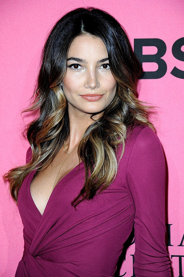<strong>Hidden highlights</strong><br> This peek-a-boo highlight trend is the big, elegant sister of the dip-dye balyage trend of the mid 2000s. Like Victoria's Secret model Lily Aldridge's dark hair here, the secret is all in the styling. Tip: Talk this through with your hairdresser and make sure they know how extreme you're willing to go. Sometimes, less is more.