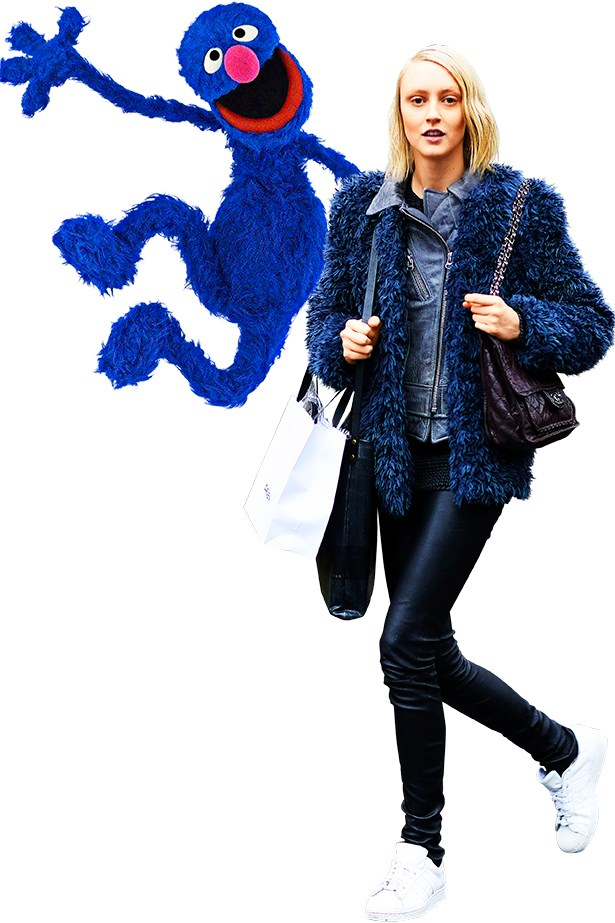 <p>A model off-duty running from show-to-show with Grover.</p>