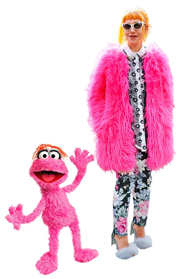 <p>A florescent pink saggy coat masterfully paired with Alexander Wang fluffy heels.</p>