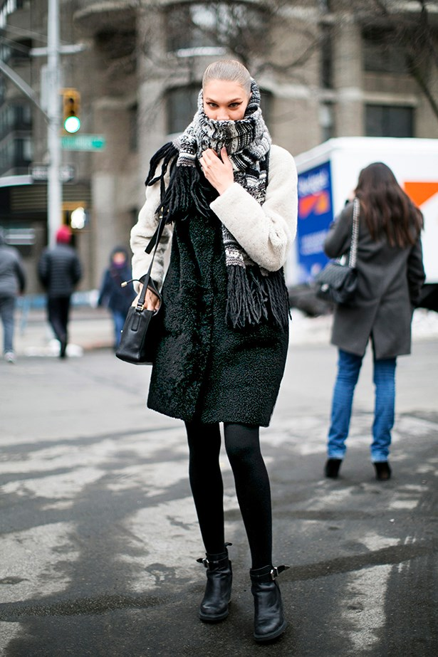 """""""Don't step out in winter without asuper‑long, chunky-knit scarf. I love the way she's toned hers intoher outfit andlooped it likeshe means it."""""""