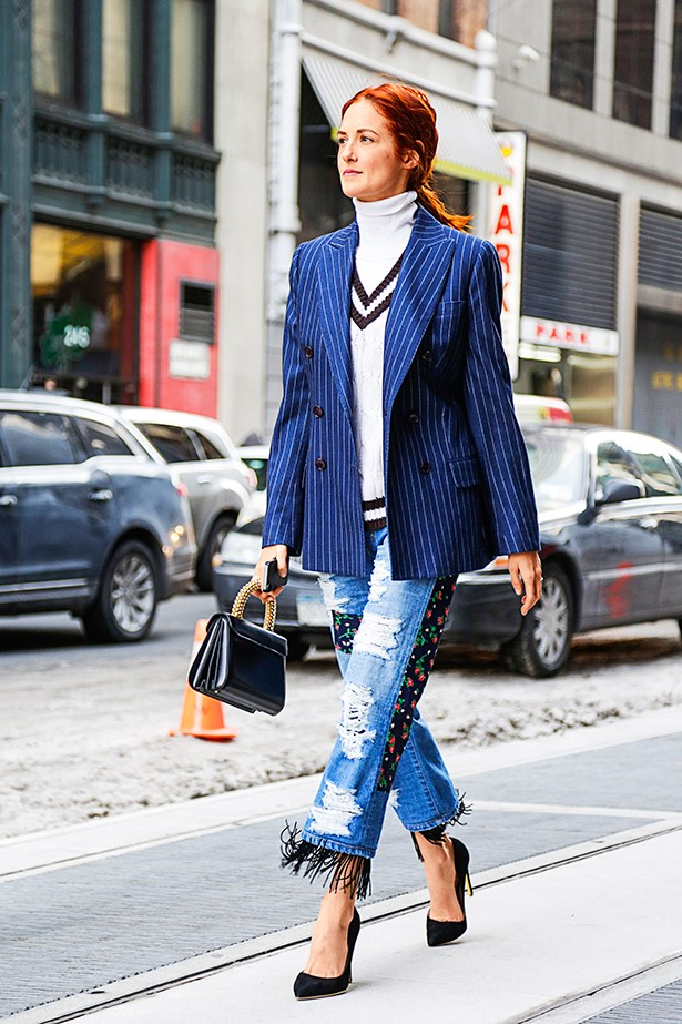 """""""Patched denim trimmed with a little DIY-style fringing perfectly captures the '90s spirit. Classic pumps and a slick bag kicks the look into 2014."""""""