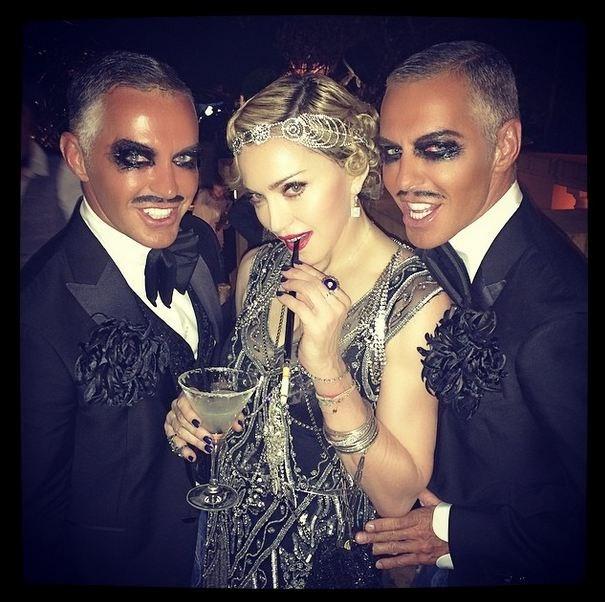 The Queen of pop posed alongside DSQUARED2 designer twins Dean and Dan Caten wearing a custom chain piece by Australian bridal designer Johanna Johnson. <br> Credit: Instagram