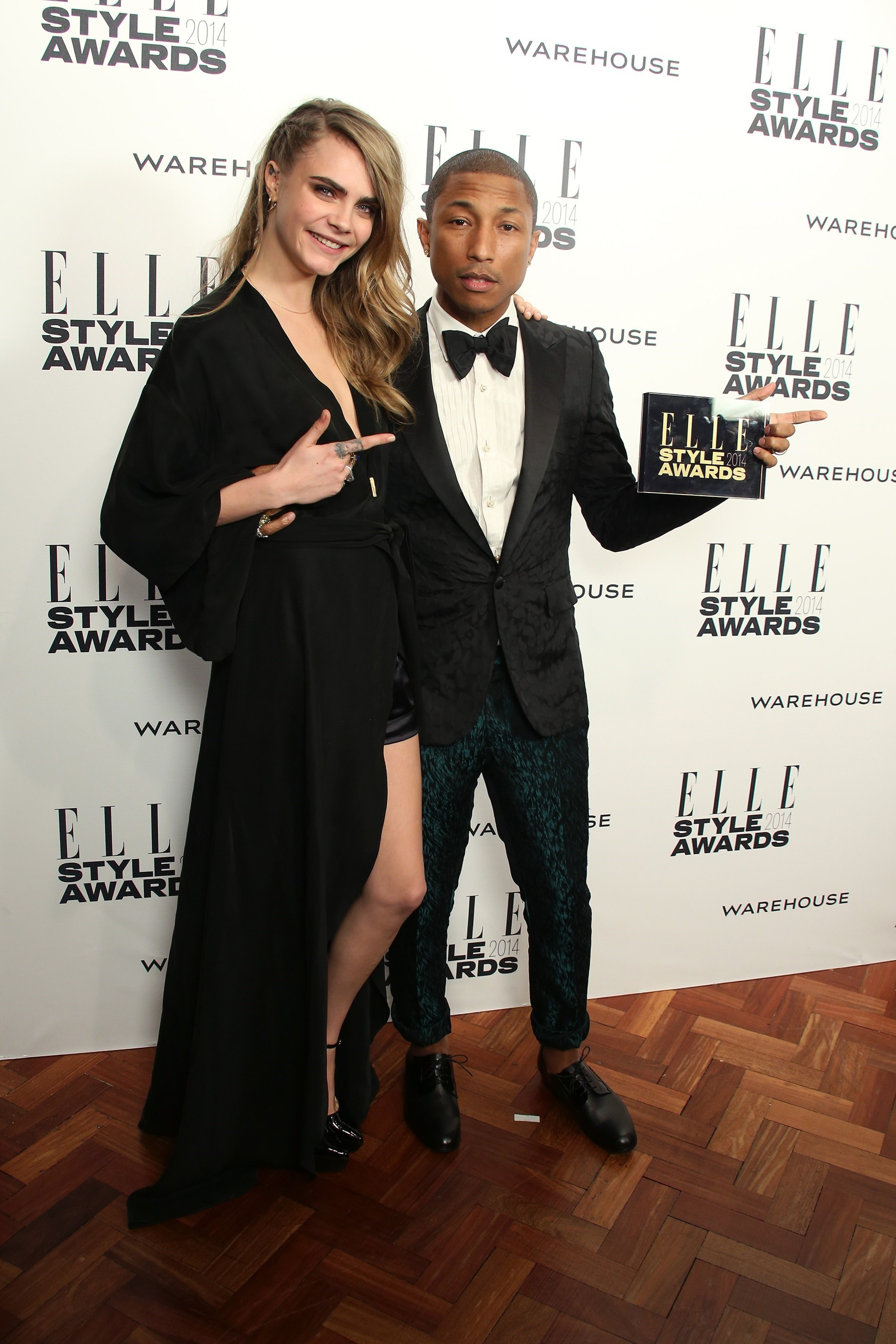 Cara Delevingne and Pharrell Williams at the 2014 ELLE Style Awards