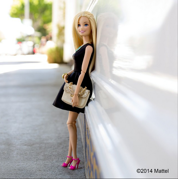 """""""Little black dress, favorite quilted bag and my always-in-style pink stilettos...can't go wrong! #ootd"""" <br> Barbie's strikes a pose for her outfit of the day. Note the on-trend braid. <br><br> Instagram: @barbiestyle"""