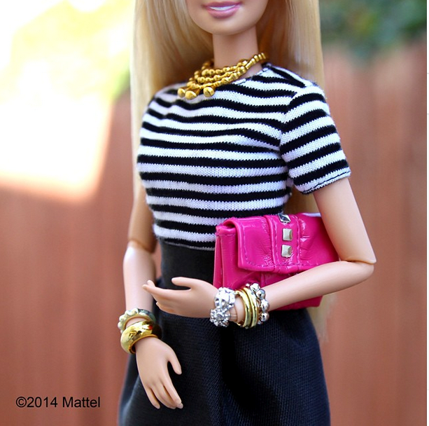 """""""I love to take classic stripes and make them my own with plenty of (pink!) accessories. 💕#ootd"""" <br> Barbie gives us a lesson in how to include pink.<br><br> Instagram: @barbiestyle"""