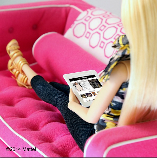 """""""Catching up on @styledotcom, every fashion girl's go-to.""""<BR> Barbie kicks back with her iPad and style.com <br><BR> Instagram: @barbiestyle"""