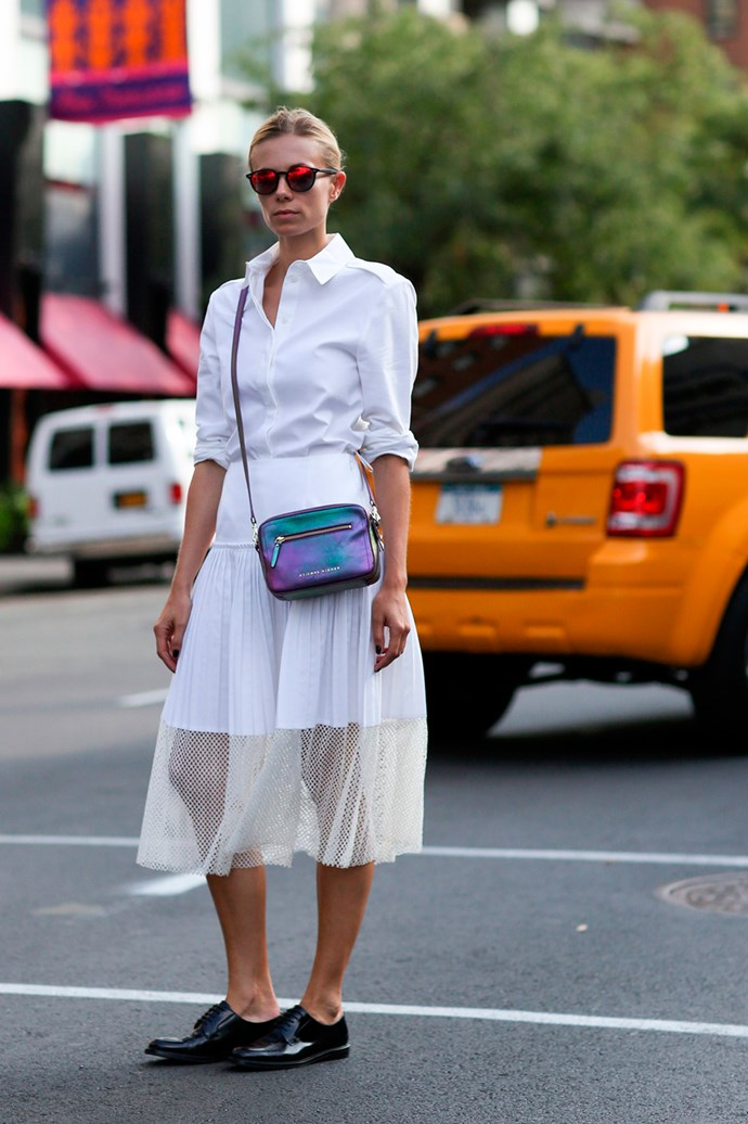 A crisp-white look offset with a petrol finish Etienne Aigner handbag at New York Fashion Week.