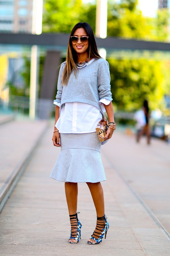 How to dress up grey sweater? Casually work it with a white shirt, peplum skirt and accents of gold.