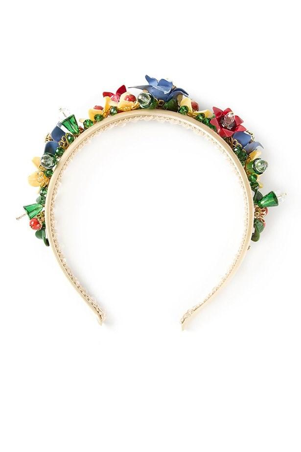 "Headband, $1,338, Dolce & Gabbana, <a href=""http://www.farfetch.com/au/shopping/women/dolce-gabbana-floral-headband-item-10747589.aspx?storeid=9306&ffref=lp_11_"">www.farfetch.com</a>"