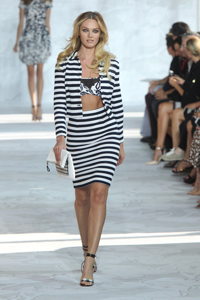 Blonde bombshell Candice Swanepoel struts her stuff for Diane Von Furstenberg in a two-piece striped suit from the designer's SS15 collection