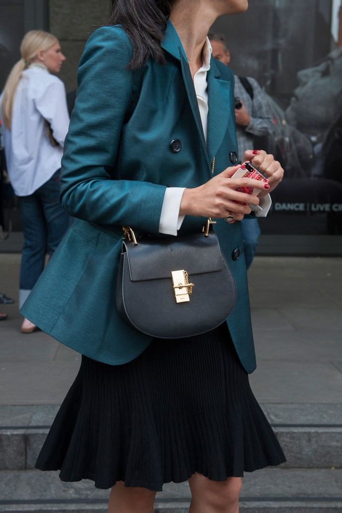 """<strong>3. (A)cross your heart</strong><br> Sensible? Tick. Safety-conscious? Yup. Stylish? It is now. <a href=""""http://www.elle.com.au/fashion/instant-style/2014/9/nyfw-street-style-hot-cross-bags/"""">Make like a street styler</a> and wear your favourite bag across the front of your body."""