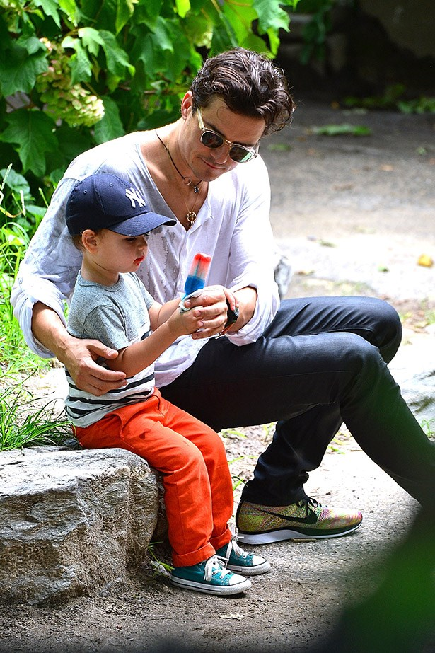 Orlando and Flynn Bloom, sharing an ice block in the park.