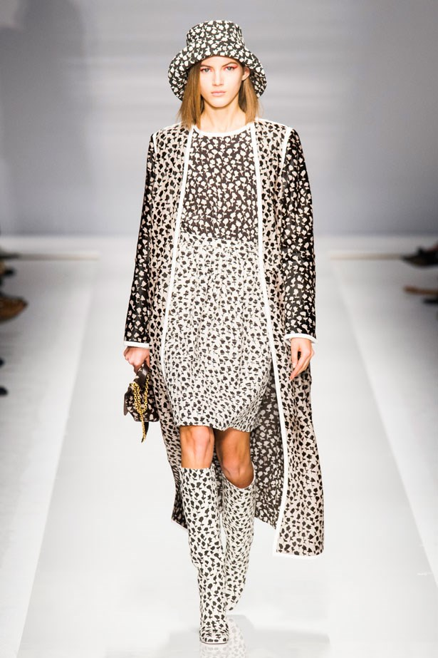 <strong>Max Mara</strong><br><BR> At Max Mara models evoked the feel of the house's iconic 1971 campaign starring Anjelica Huston and wore floppy, folded-up hats, stacked heels and long dresses that stopped mid-calf. We love.