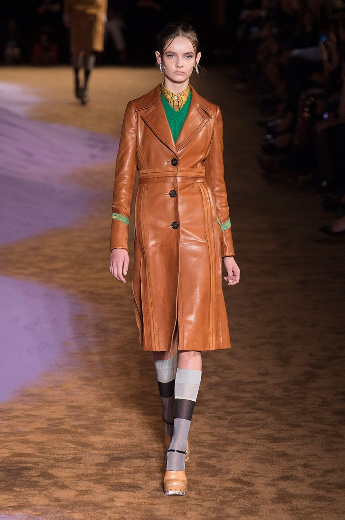 <strong>Prada </strong><br><BR> The caramel leather trench: the eternal uniform of a 1970s cinematic heroine. While Miuccia Prada is never one to copy-paste from any reference, many of her pieces at Prada, including the patchwork dresses, and high-collared shirting, had a total retro good-girl feel.