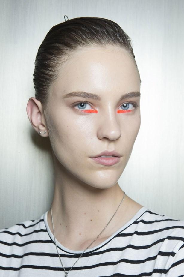 <p><strong>Peter Som </strong> <p/> <p>Makeup artist Yadim used a Maybelline Color Sensational Vivids Lip Color in Vibrant Mandarin along the lower lash line. <p/>