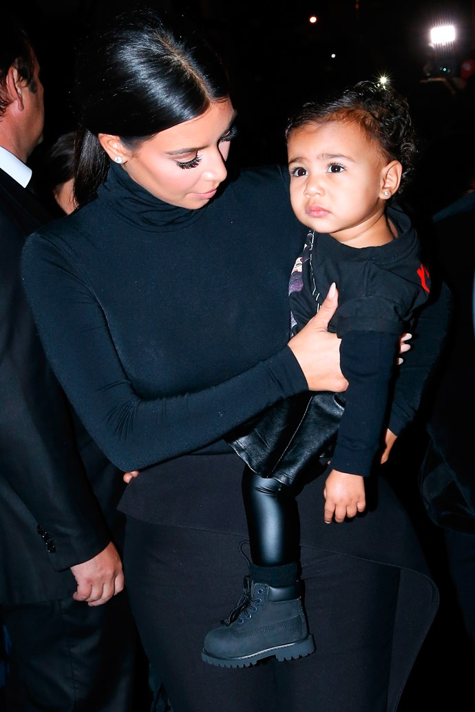 """<strong>North West made her PFWSS15 debut (in leather) at Balenciaga</strong><br><BR> Step aside <a href=""""http://www.elle.com.au/news/fashion-news/2014/8/barbie-has-joined-instagram-and-is-showing-off-her-fashion-chops"""">Barbie</a>, there's a new street style star in town. Among a blinding flash of light from prowling paparazzi, Baby North West made an entrance when she attended the Balenciaga show decked out in all black everything: a Yeezus tour tee, leather pants and a leather skirt. It's worth pointing out that little North's little leather look was not unlike Daddy Kanye's infamous Givenchy by Ricardo Tisci kilt which he wore during his 'Watch The Throne' tour with Jay Z, then infamously regretted after rapper MC Lord Jamar threw some epic shade by penning a song called 'Lift Up Your Skirt'. THE MORE YOU KNOW…"""