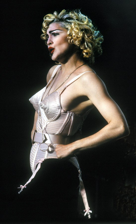 <strong>The Cone Bra </strong><br><BR> Madonna wore Gaultier's his iconic pink satin cone bra corset for her 1990 Blonde Ambition Tour.