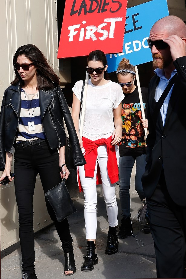 We'd nab one of those signs too, Kendall. The supe-in-the-making takes a souvenir from the Chanel show in Paris.