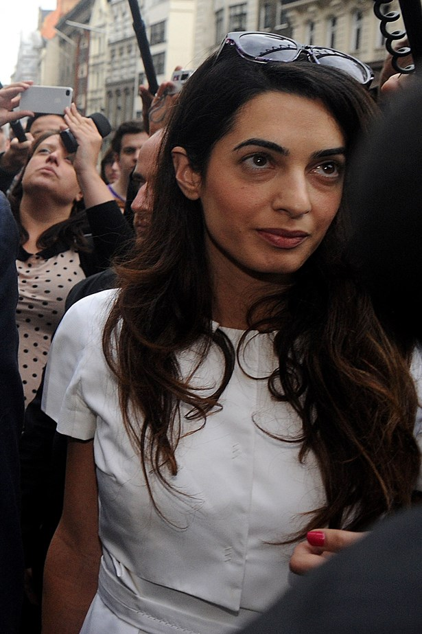 Even when working, in this case leaving court in 2011 with WikiLeaks founder Julian Assange, Amal looks timeless.