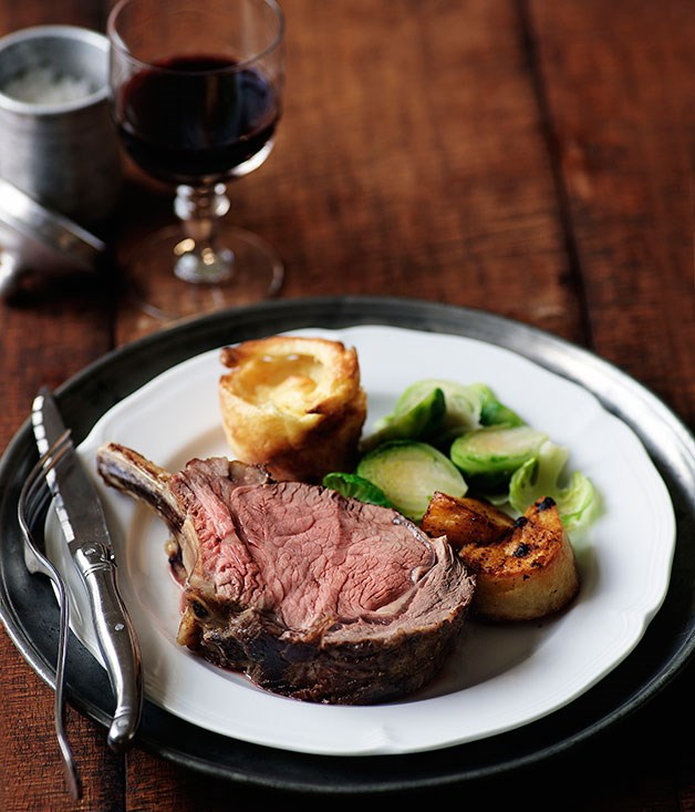 Prime rib of beef with Yorkshire puddings, roast potatoes and Brussels ...