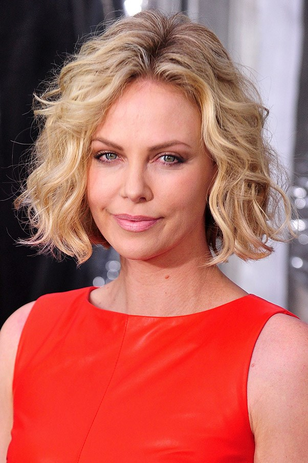 "<strong>The blunt crop</strong>: ""Most face shapes suit blunt crops, but it can often look harsh on square faces - it will only enhance the shape, not soften it."" Blunt cuts can also add thickness to finer hair, like Charlize Theron's. To style, spray damp hair with sea salt spray, twist into pieces and let air dry."