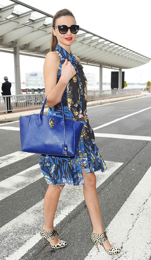 Snapped in Tokyo earlier in the year, Kerr clashes patterns, wearing Alexander McQueen and Bionda Castana leopard –print shoes.
