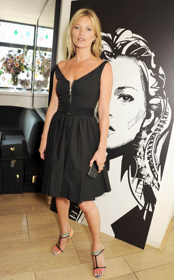 <strong>Kate Moss</strong> <br><br><strong>What she earned:</strong> $5.7 million <br><br><strong>How she earned it:</strong> The iconic Ms. Moss has endorsement deals with Longchamp, Mango, Rimmel, and Vogue Eyewear , as well as a long-time design deal with TopShop. <br><br><em>Pictured here at the celebrity preview of her Carphone Warehouse Collection, wearing a classic  Prada 50s style dress, and neon strappy Louboutins. </em>