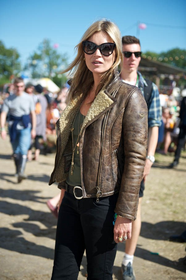 The classic festival style icon, Moss teams heavy, sheepskin-lined leather with delicate gold jewellery at Glastonbury 2013.