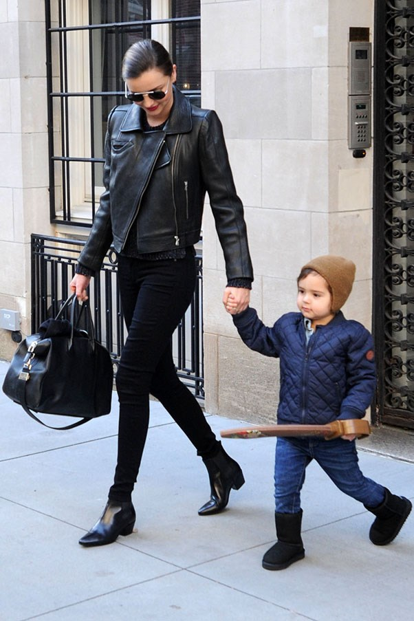 On the streets of New York with son Flynn in December 2013.