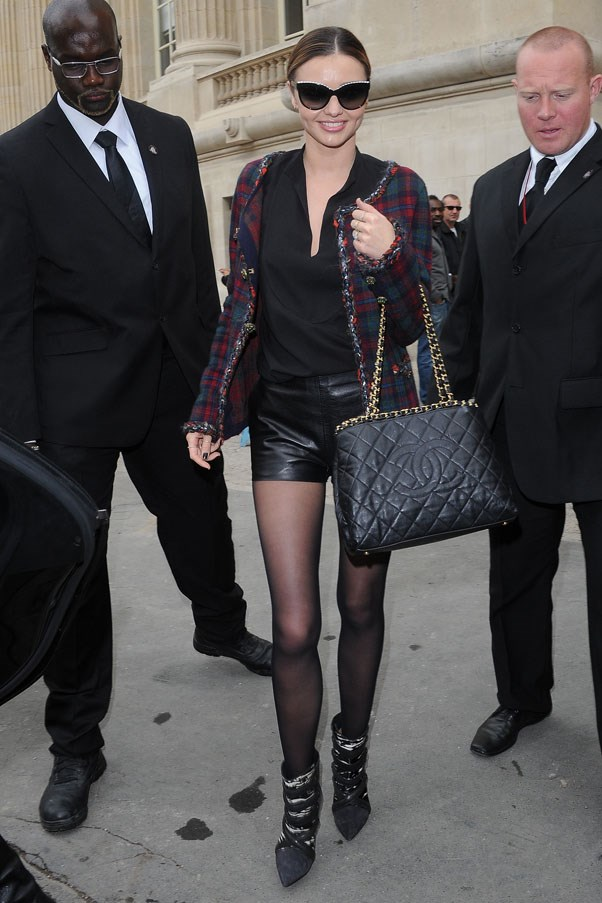 Leaving the Chanel show at Paris Fashion Week in October 2013.