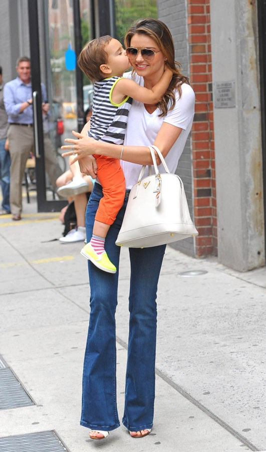 Mid-kiss with son Flynn in New York, July 2013.