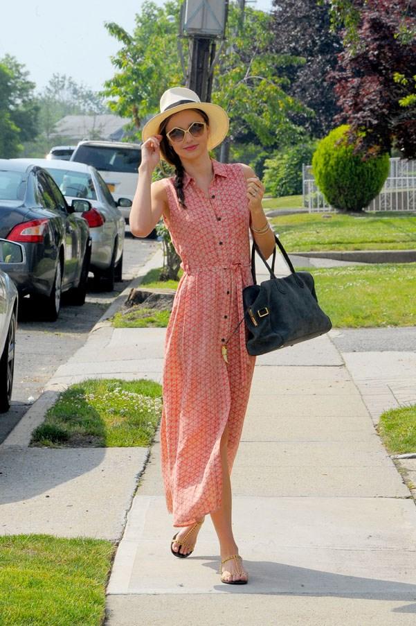 Wearing her wardrobe staple maxi-dress in New York, June 2013.