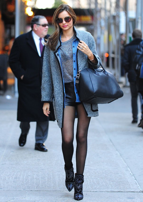Sporting her go-to boots and stocking combination in New York, November 2012.