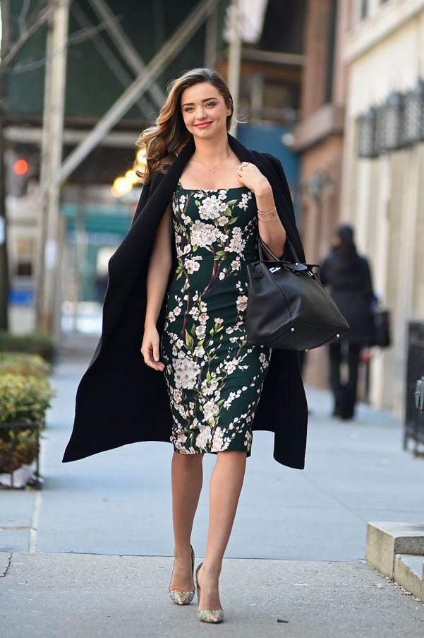 Polished perfection in a fitted floral dress, coat and ladylike pumps on the streets of New York on March 26, 2014.