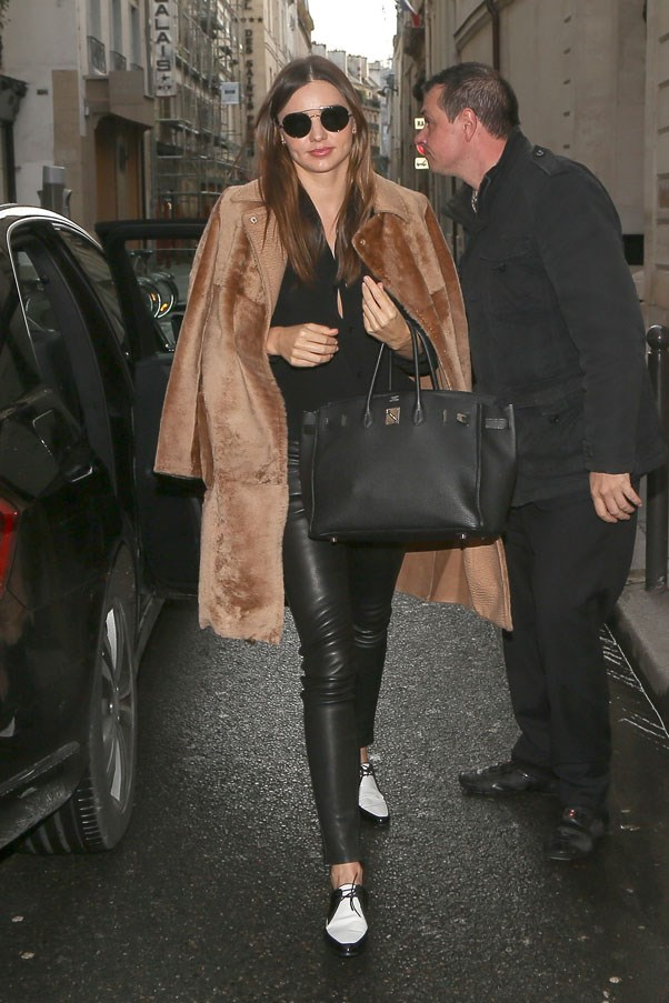 In Paris for the autumn/winter 2014-15 collections, weather leather tights and Balenciaga brogues on February 27, 2014.
