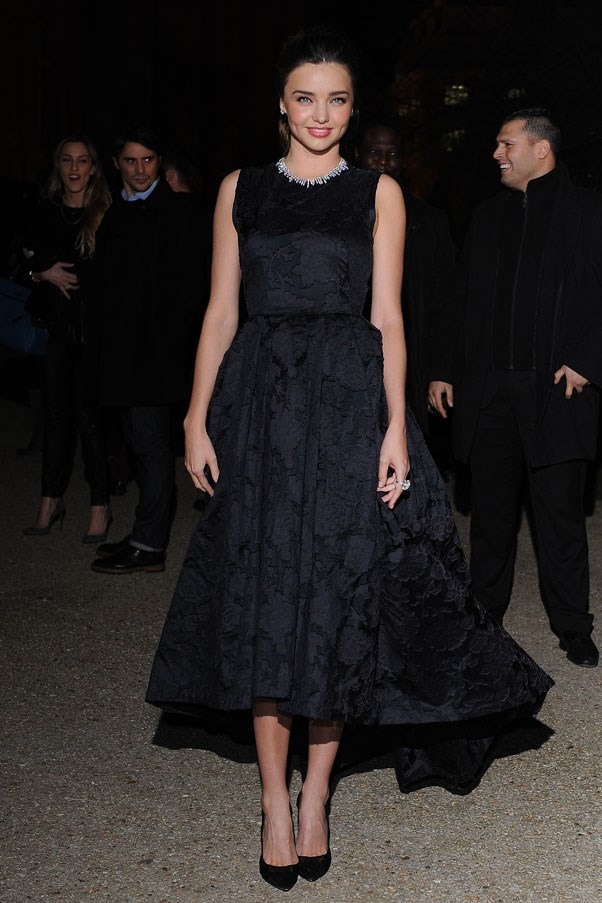 Attending the H&M show at Paris fashion week on February 26, 2014.