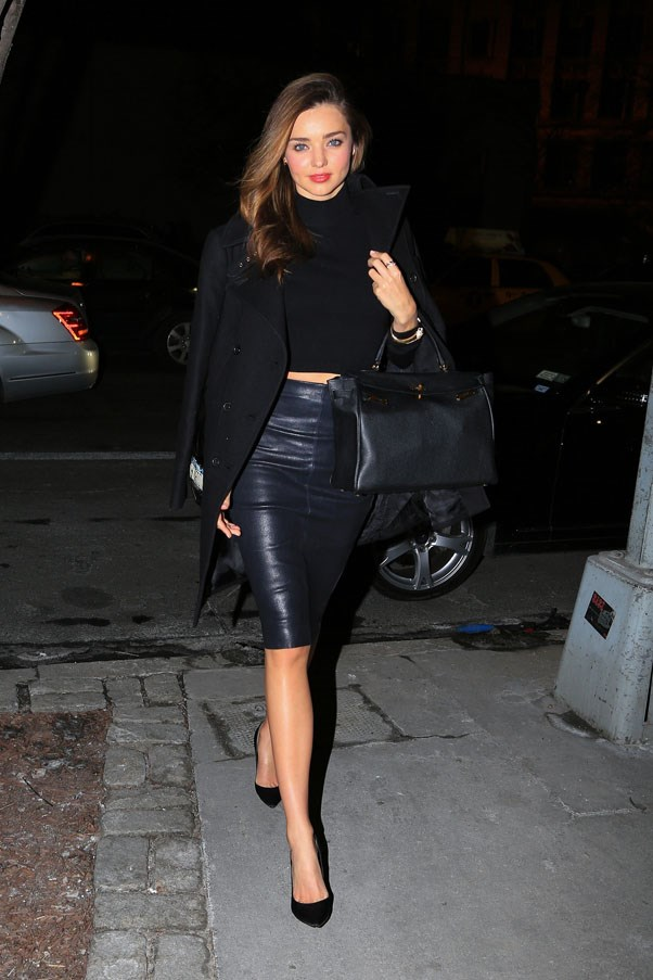 Stepping out in New York on January 31, 2014 wearing a leather skirt and cropped turtleneck. Kerr carries an Hermes Kelly bag.