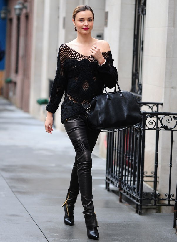 Braving the cold with an off-the-shoulder sweater and sleek leather pants on December 19, 2013 in New York. Kerr carries the Givenchy Antigona bag.