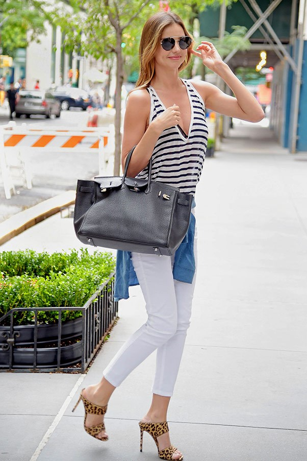 Casual in breton stripes and white jeans while out in New York on July 19.